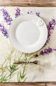 Plate and fork on vintage wooden dining table — Stock Photo