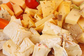 Cut cheese background — Stock Photo