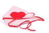 Envelope with red hearts ribbon — Photo