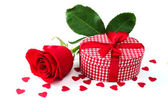 Rose and gift — Stock Photo