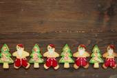 Christmas cookies on wooden table — Stock Photo