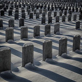 Identical soldiers graves in winte — Stock Photo