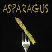Asparagus on a fork — Stock Photo