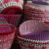 Colorful paper cup for muffins — Stock Photo