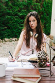 Young beautiful female sitting outside and studying hard. — 图库照片
