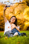 Mother and baby - capturing moments — Stock Photo