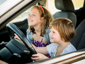 Children driving car — Stock Photo