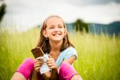 Girl enjoying chocolate — Stock Photo
