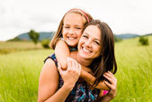 Mother and child hugging — Stock Photo