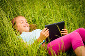 Mobility -  watching tablet outdoor — Stock Photo