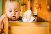 Domestic chores - baby opens drawer — Stock Photo