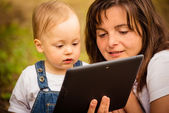 Mother, child and tablet — Stock Photo