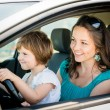 Mother and child driving car — Stock Photo #55648589