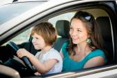 Mother and child driving car — Stock Photo