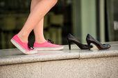 Woman in sneakers — Stock Photo
