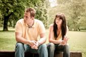 Relationship problems - couple in park — Stock Photo