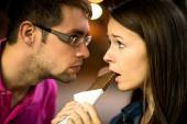 Caught in the act - woman with chocolate — Stockfoto