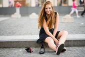 Comfort wins - sneakers versus high heels — Stock Photo