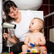 Mother and baby - drying hairs — Stock Photo #67684587