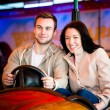 Young couple riding car in amusement park — Stock Photo #69699071