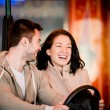 Young couple riding car in amusement park — Stock Photo #69699147