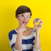 A girl with a donut — Stock Photo