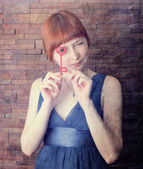 Beautiful girl with a red key — Fotografia Stock