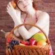 Redhead girl with a basket of fruits — Stock Photo #56131325