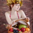 Redhead girl with a basket of fruits — Stock Photo #56131347