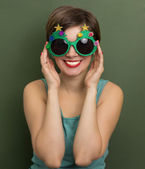 Beautiful woman with Christmas party glasses — Stock Photo