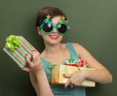Beautiful woman with Christmas presents — Stock Photo