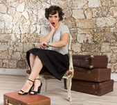 Beautiful woman with suitcases — Stockfoto