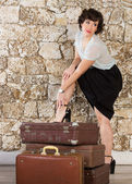Beautiful woman with suitcases  — Stock Photo
