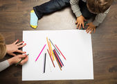 Toddler drawing on the floor — Stock Photo