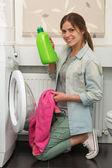 Beautiful girl doing laundry — Stock Photo