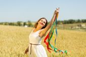 Happy girl holding colorful ribbons — Stockfoto