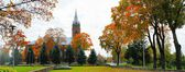 Church in little town at autumn time — Stock Photo