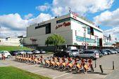Vilnius city shop center CUP and orange cycles — Stock Photo