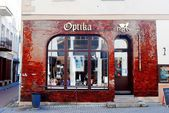 Vilnius city town old street with Optika shop — Stock Photo