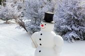 Snowman and his wooden broom — Stockfoto