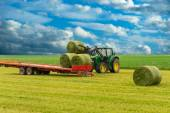 Tractor and hay bales — Stock Photo