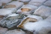 Cobble stones covered in ice — Stock fotografie