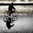 Постер, плакат: Silhouette of cyclist on bright day