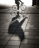 Back lit cyclist in evening light — Stock Photo
