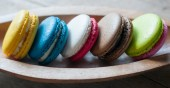 Macaron on wood bowl — Stock Photo