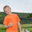 Cute gay boy in the forest shows all ok. — Stock Photo #57077611