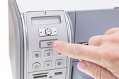 Office worker presses the button the printer. Close-up. — Stock Photo