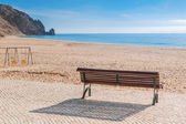 Secluded place for meditations on the sea shore. On a bench near the swing. — Stock Photo