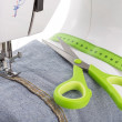 Dressmaker scissors, sewing machine and meter. Textile close-up. — Stock Photo #57638455