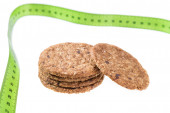 Oatmeal cookies on a background of a meter to measure. Diet for weight loss. — Stock Photo
